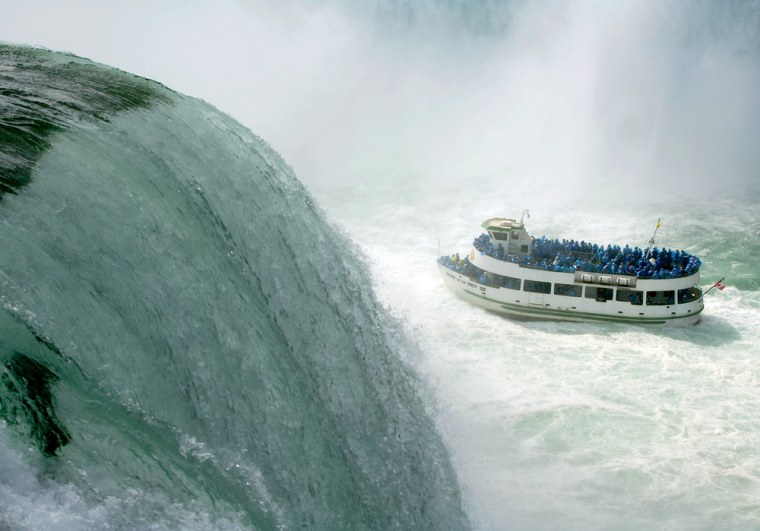 The Maid of the Mist navigates the turbulent waters of the lower Niagara river at the base of Horseshoe Falls, at Niagara Falls State Park, N.Y. Niagra Falls boasts a winning combination of sprawling gaming complexes, a bustling tourist promenade, and some of the worlds' most amazing waterfall views.