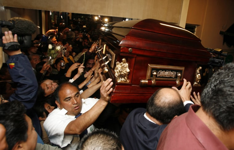 People carry the coffin containing the body of Sergio Gomez, the lead singer for the top-selling band K-Paz de la Sierra, at a funeral parlor in Mexico City,on Tuesday. Gomez, who was tortured and strangled to death, is the newest in a string of attacks that have driven fear into the heart of Mexico's music industry.