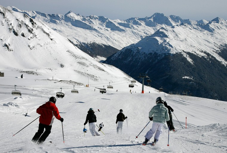 Skiers enjoy the perfect conditions with a lot of fresh fallen snow and blue skies on Nov. 18, on the Weissfluhjoch mountain above Davos in southeastern Switzerland. Due to the early and rich snowfalls many ski resorts in the Swiss mountains already opened for the new season.