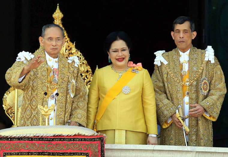 Thai King Bhumibol Adulyadej, left, waves to the crowds next to Queen Sirikit and Crown Prince Maha Vajiralongkorn during his 80th birthday celebrations at the Grand Palace in Bangkok on Wednesday.