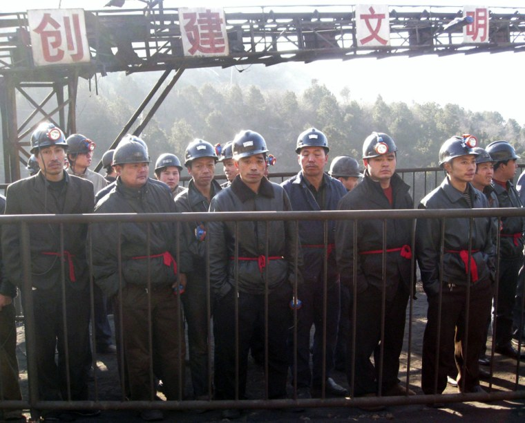 Rescuers prepare to search for victims at a coal mine where a gas blast took place in Hongtong county