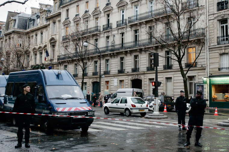 Image: French policemen after a parcel bomb exploded in Paris.