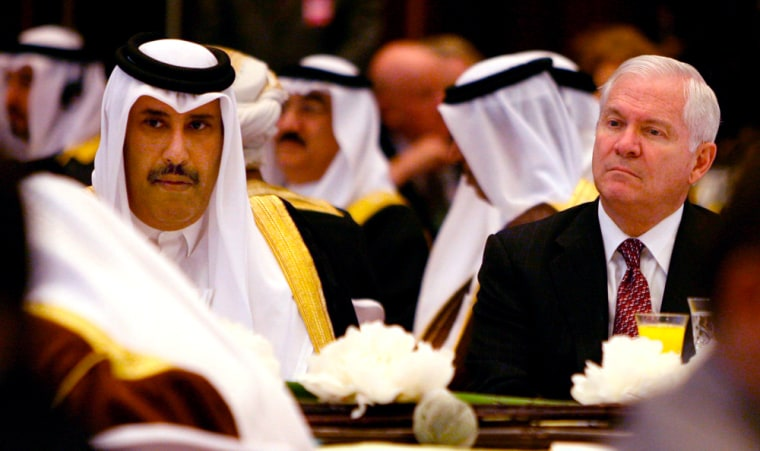 Image: US Secretary of Defence Robert M. Gates (right) seen flanked by Qatar's Prime Minister and Minister of Foreign Affairs, Sheikh Hamad Bin Jassim Bin Jaber Al Thani (left) during the opening session of the 4th International Institute for Strategic Studies