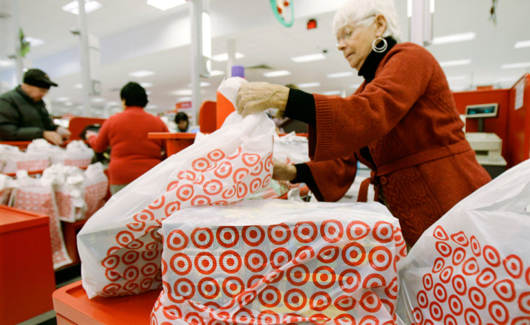 Image: A clerk bags purchases at a Target store