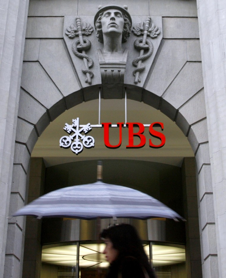 A woman walks past the UBS office at the Bahnhofstrasse in Zurich