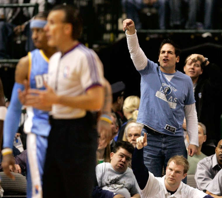 Image: Mavericks owner Cuban shouts at the referee to count the basket after a Maverick was fouled in the first half of their NBA  basketball game against the Nuggets in Dallas
