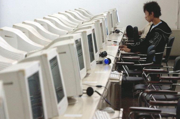 Image: A Chinese man uses the computer at an internet cafe in Beijing