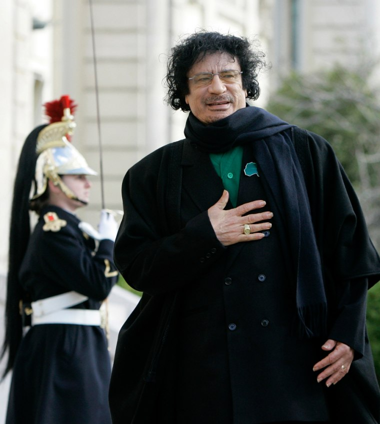 Image: Libyan leader Gaddafi arrives at the National Assembly in Paris