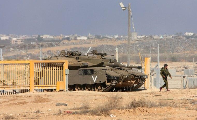 Image: An Israeli tank leaves Gaza through the Suffa Crossing border between Israel and Gaza Strip,.
