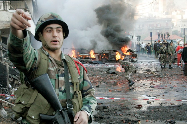Image: Lebanese soldiers secure the site of an explosion in Christian town Baabda east of Beirut.
