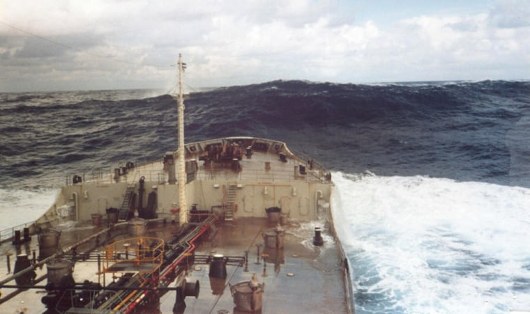 Image: A rogue wave estimated at 60 feet moves away from a ship after crashing into it a short time earlier, in the Gulf Stream off Charleston, South Carolina, with light winds of 15 knots.
