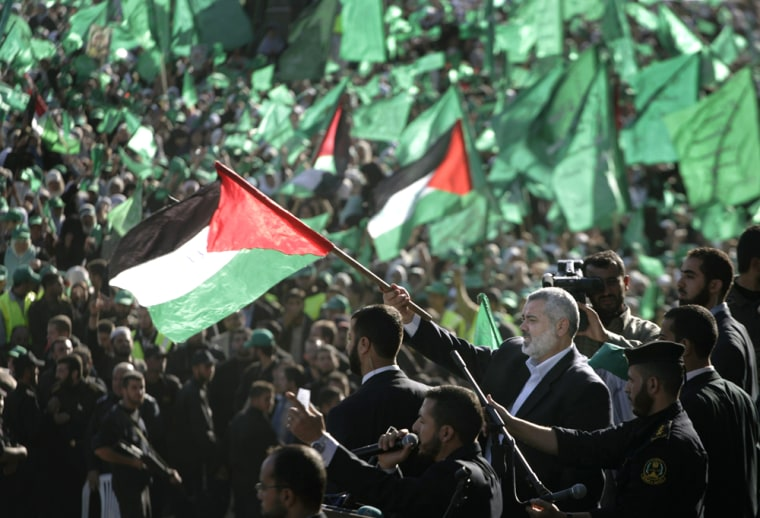 Image: Palestinian Prime Minister of the Hamas, Ismail Haniyeh, waves a Palestinian flag