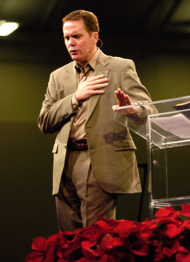 Image: Senior Pastor Brady Boyd speaks to the congregation during the first Sunday service at New Life Church