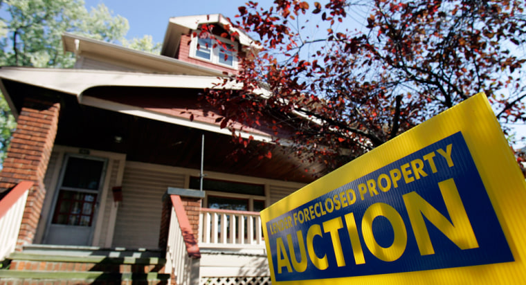 Image: An auction sign is seen in front of a foreclosed home in Shaker Heights, Ohio
