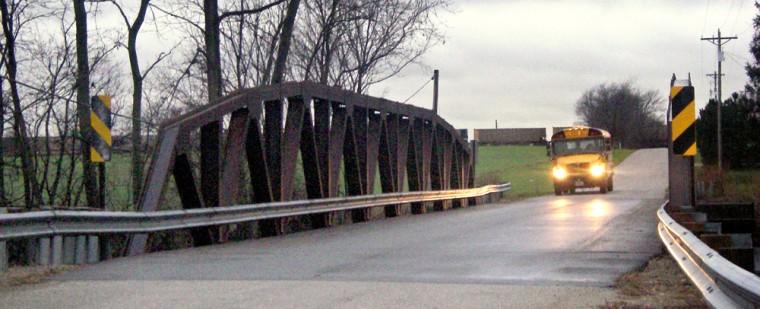 Image: School bus approaching bridge