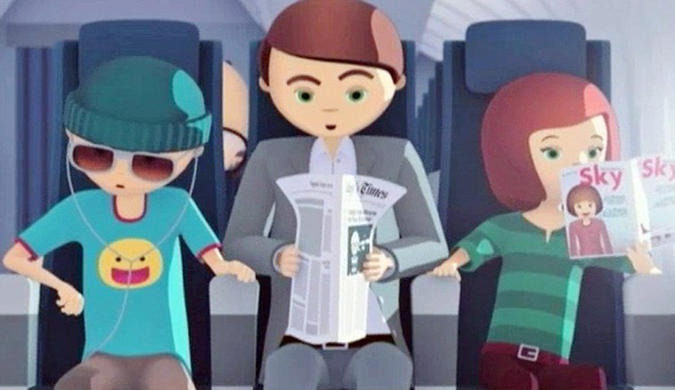 This undated video frame grab provided by Delta Air Lines shows a scene from a short made-for-Internet video in which passengers fight over an arm rest.