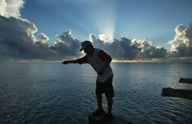 Image: An indigenous Miskito boy fishes on a portion of the harbour in Puerto Cabezas town