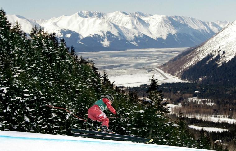 Image: A skier races down the hill at Alyeska Resort in Girdwood, Alaska