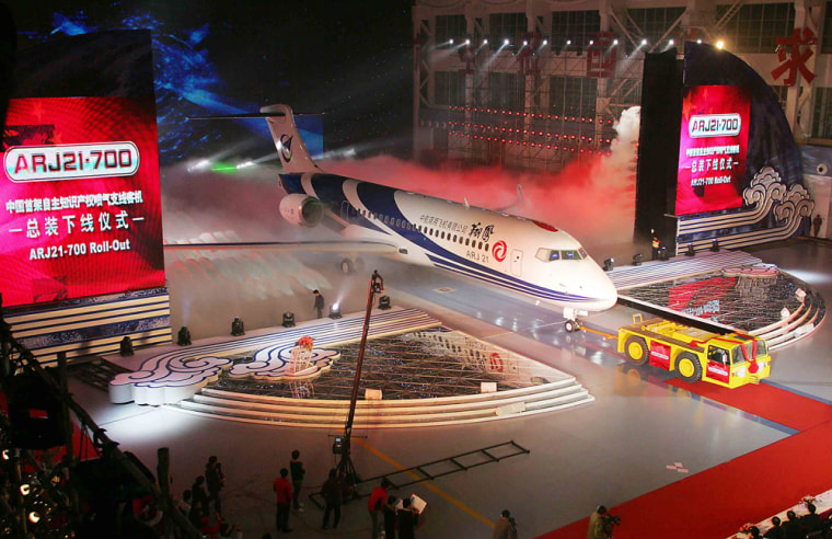 Image:  China's first home-grown regional jet, the ARJ21-700, rolls off the production line in Shanghai.
