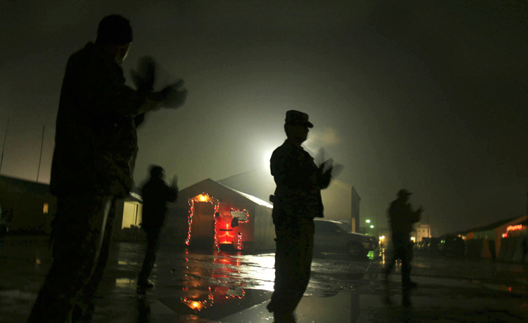 Image: U.S soldiers clap as they listen to Christmas carols at Phoenix military camp, in Kabul, Afghanistan,