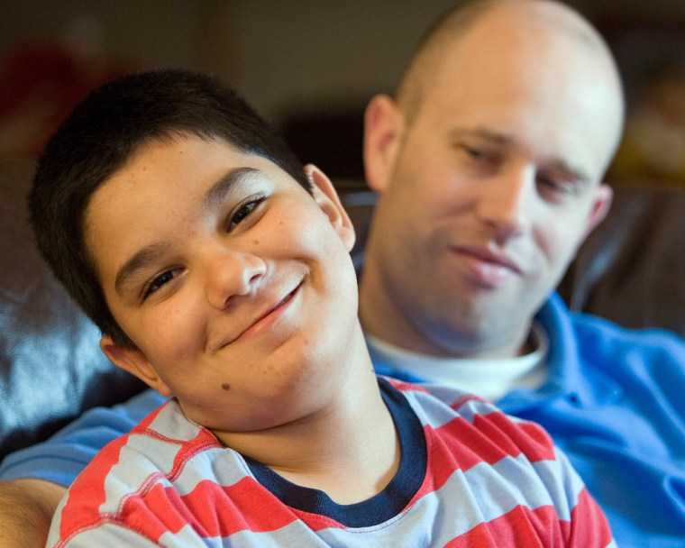 Image: Scott Southworth, right, is seen with his adopted son, Ala'a