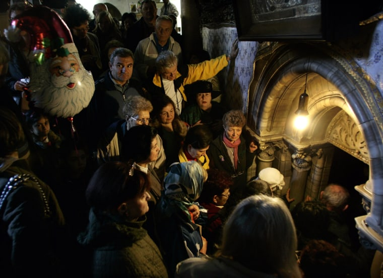 Christian pilgrims wait Monday to enter the Grotto at the Church of the Nativity, traditionally believed by many to be the birthplace of Jesus Christ, in the biblical West Bank town of Bethlehem.
