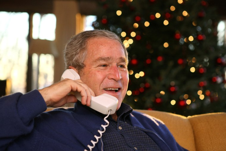 President Bush makes Christmas Eve telephone calls to members of the armed forces at Camp David on Monday.