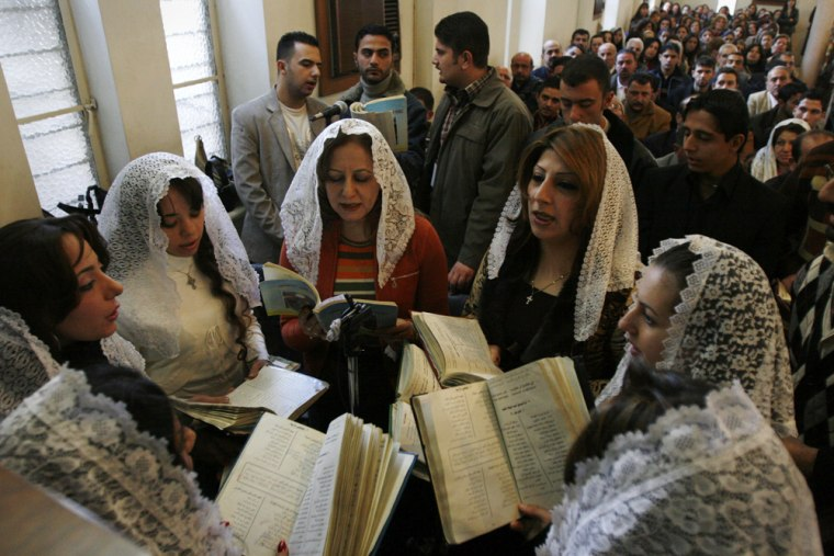 Iraqi Christians attend Mass in Baghdad on Tuesday.