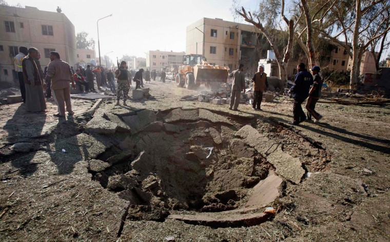Image: A crater is left in a pavement after a suicide truck bomb attack in Beiji