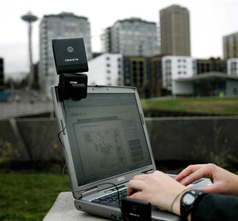 Image: The Clearwire wireless card is shown in use with the optional external antenna