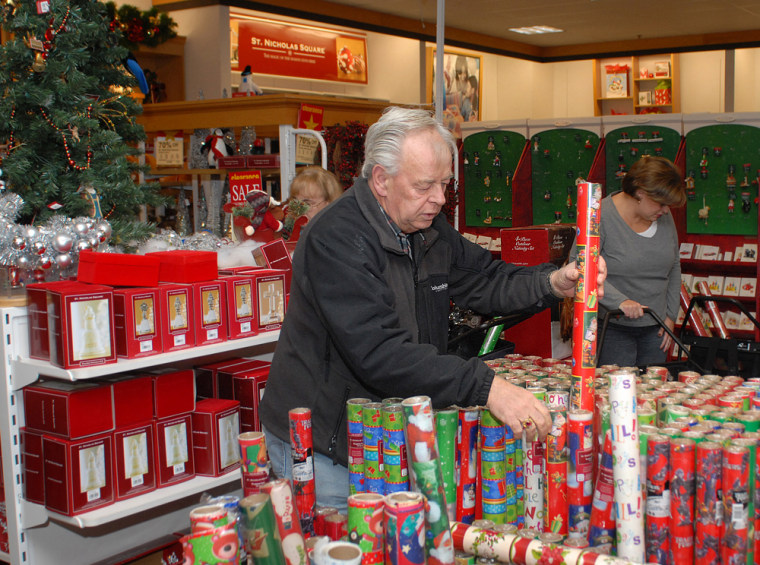 Image: Wendell Davis takes advantage of early morning after Christmas sales at the Kohl's store in Lisbon Conn.
