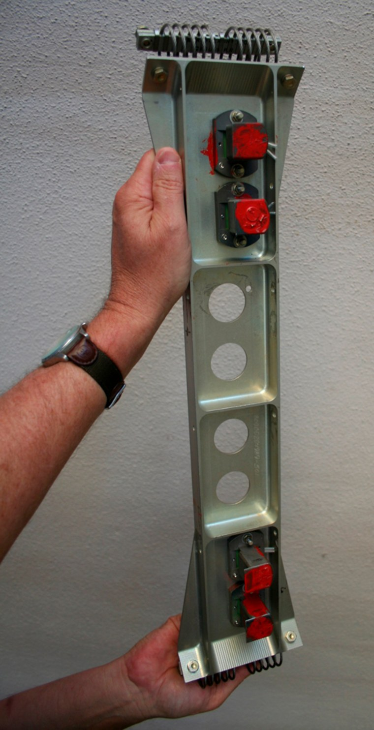 Image: Panel containing four engine cutoff sensors and suspect wiring, similar to the one causing problems inside the external fuel tank on the space shuttle Atlantis, is displayed at Kennedy Space Center
