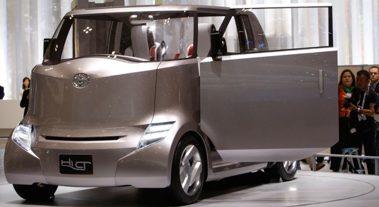 Image: Visitors look at Toyota Motor Corp's Hi-CT concept vehicle, an urban truck inspired by the silhouette of a gorilla, during the 40th Tokyo Motor Show