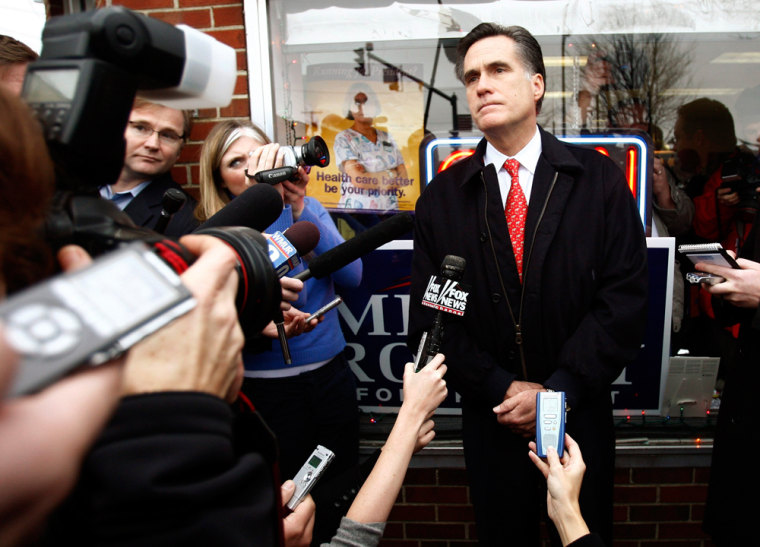 Republican presidential candidate Mitt Romney speaks to reporters about the assassination of former Pakistani Prime Minister Benazir Bhutto.