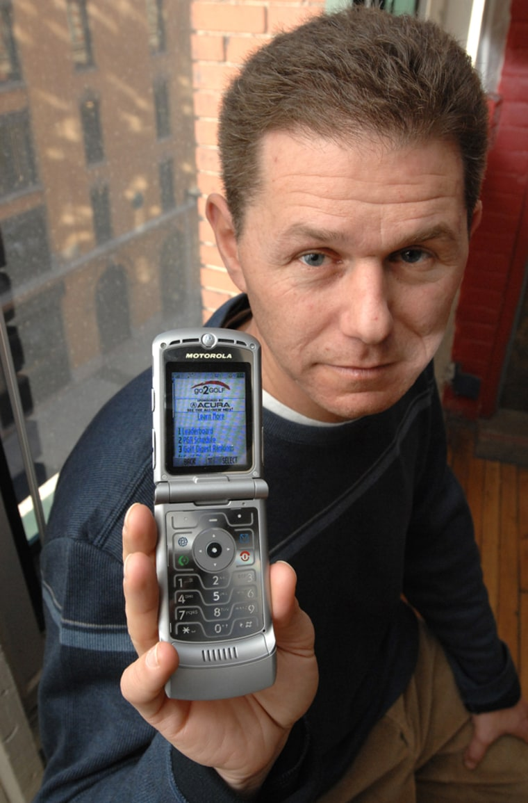 Image: Rob Adler, CEO of go2 Media holds a cell phone displaying an example of the company's efforts to deliver advertising and content targeted to the interest and location of the user