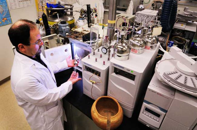 Image: Sandia researcher Ted Borek used gas chromatography and mass spectrometry to analyze vapors produced by mild heating of pot samples