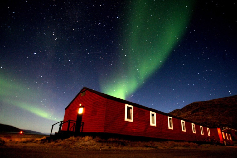 Image: The Aurora Borealis glows in the sky, September 03, 2007, in the Greenland town of Kangerlussuaq.