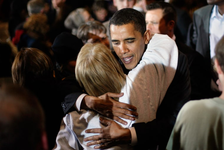 Image: Senator Barack Obama hugs a supporter during a campaign stop in Iowa.