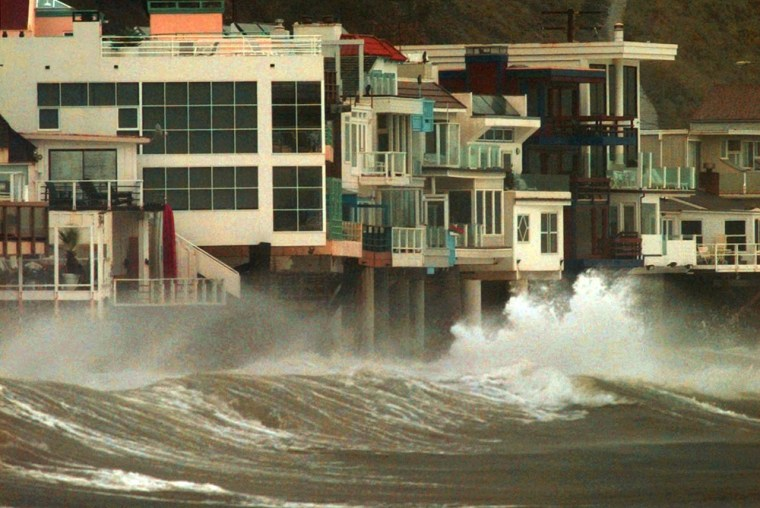 An El Nino-powered storm pounds the pilings of ocean front homes in Malibu, Calif., in this Dec. 5, 1997, file photo. California's coastline would see costly erosion if sea levels rise by more than a few inches this century.