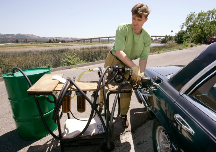 Image: Valentin Humer, president & CEO of Food & Vine, pumps recycled grapeseed oil into his Mercedes diesel