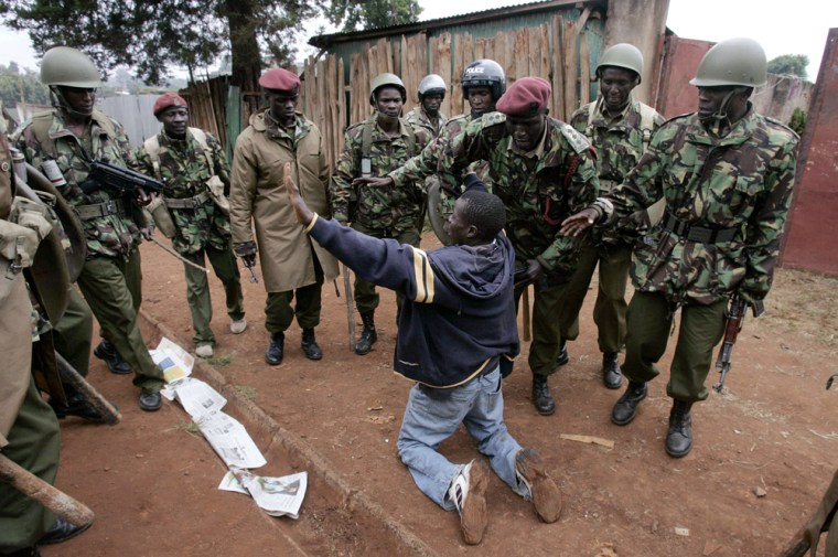 An opposition supporter begs police for mercy during protests in Nairobi