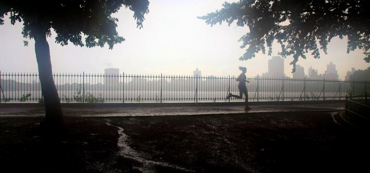 Image: A woman runs along the Central Park Resevoir during a rain shower July 11, 2007 in New York City.