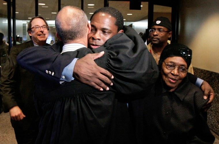 Image: Dallas Distict Court Judge John Creuzot, left, gives Charles Chatman a hug after leaving court