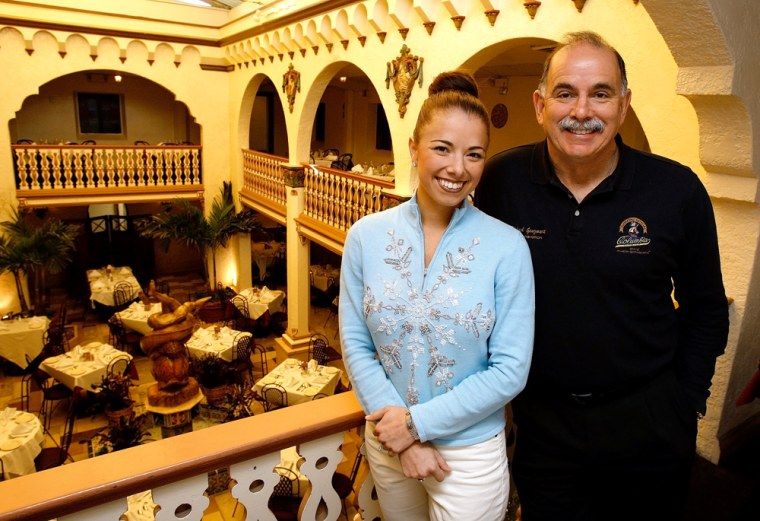 Image: Richard Gonzmart, right, whose family has owned the Columbia Restaurant in Ybor City for four generations, poses with his daughter Andrea Thursday morning Jan. 3, 2008 in Tampa, Fla.