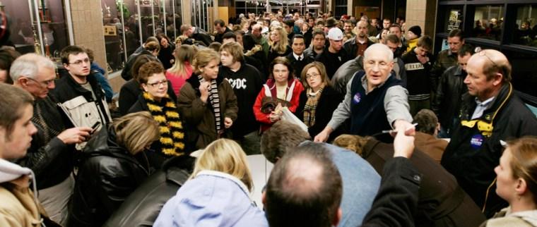 Image: Caucus goers gather inside Waukee High School in Waukee