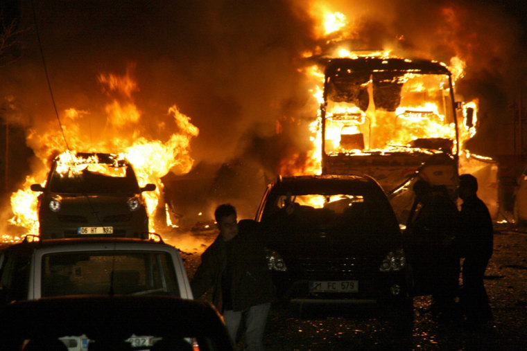 Vehicles are engulfed by flames following an explosion in the southeastern Turkish city of Diyarbakir