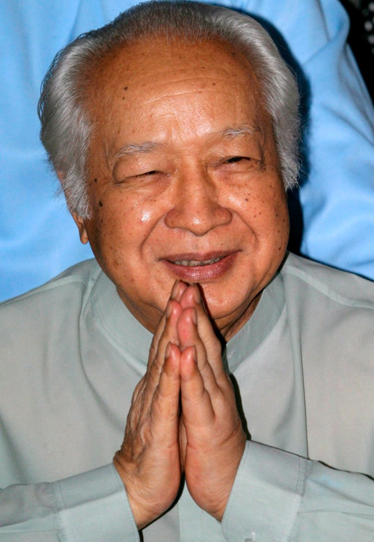 Image: Former Indonesian president Suharto saluting.