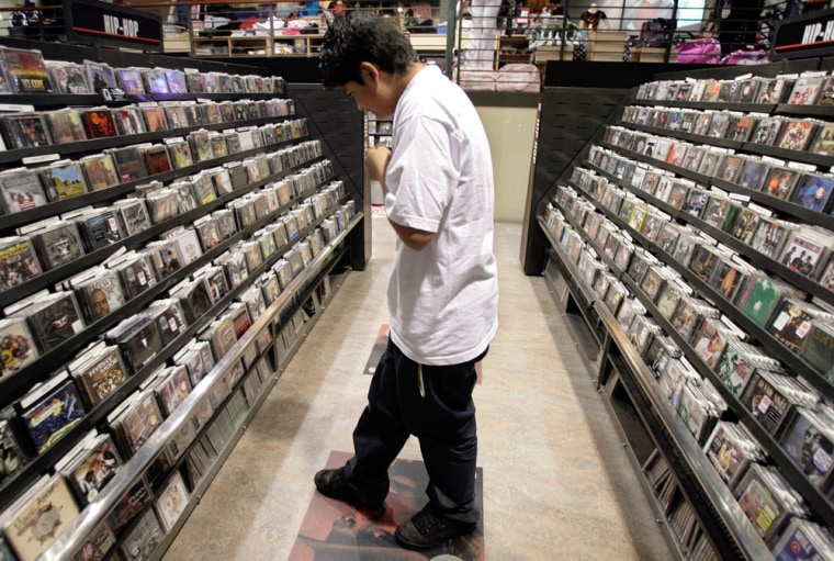 Image: Gaston Chabolla, 15, searches for CDs at a music store in Los Angeles