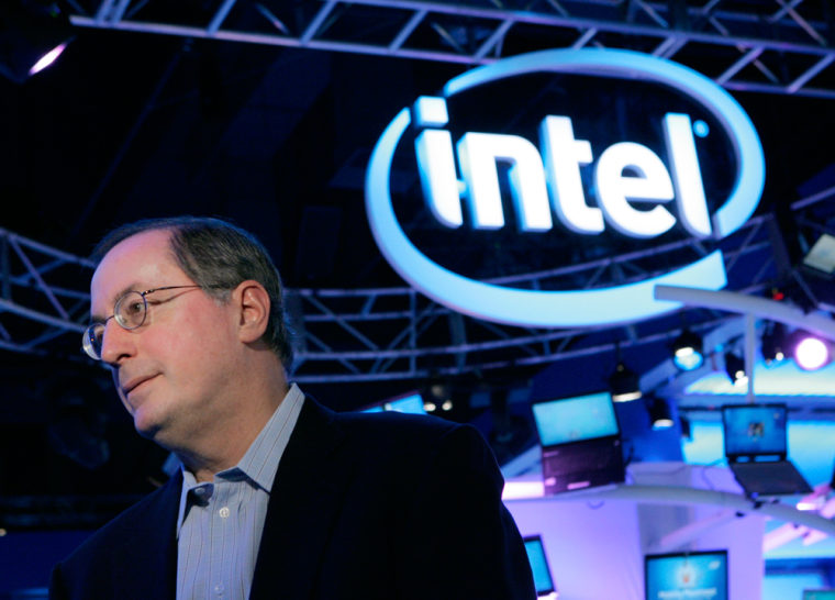 Image: Intel CEO Paul Otellini interviews with a reporter at the Intel booth at the Consumer Electronics Show