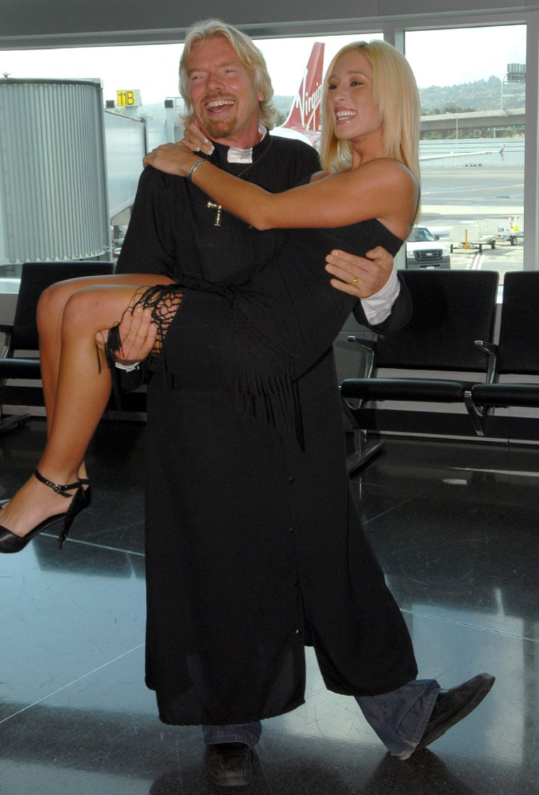 Image: Sir Richard Branson welcomes aboard Kyla Ebbert from San Diego, Calif., on Virgin America's first flight to Las Vegas.